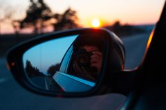 On the road with beautiful view of sunset surrounding by trees.  stock photo