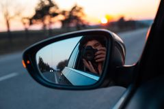 On the road with beautiful view of sunset surrounding by trees.  stock images