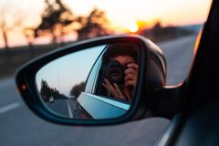 On the road with beautiful view of sunset surrounding by trees.  stock photos