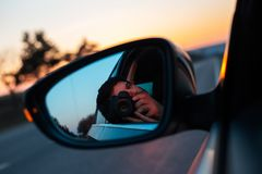On the road with beautiful view of sunset surrounding by trees.  royalty free stock image