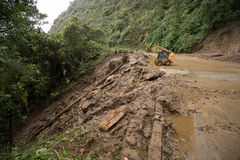 Road being cleared after a landslide in Ecuador. June 8, 2017 Baeza, Ecuador: road being cleared after a landslide triggered by rain Royalty Free Stock Photos