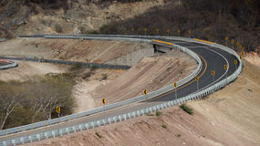 Road bend with inclination to the right side Royalty Free Stock Image