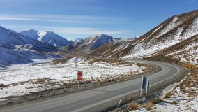 A road bend in snow covered New Zealand. royalty free stock image