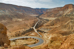 The road is bent. A picturesque valley in desert Negev in Israel Royalty Free Stock Photos