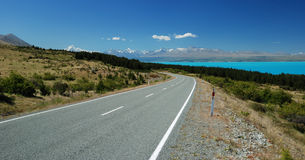 Road besides Pukaki lake Stock Photo
