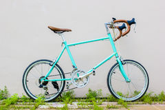 Road bicycle on grass roadside with wall background. Vintage. Soft color. Exercise sports concept Stock Photo