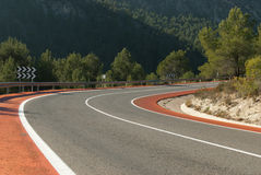 Road with bicycle lanes. Scenic bent mountain road with bicycle lanes Royalty Free Stock Images