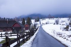 Road in Bieszczady to Wetlina and Solina, Winter day with lot of snow. Buildings in the background. Road in Bieszczady to Wetlina and Solina, Winter day with lot stock image