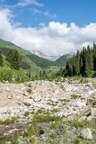 Road on  Big Almaty Lake, nature  green mountains and blue sky in Almaty, Kazakhstan, at summer Royalty Free Stock Photos
