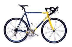 Road bike. A blue and yellow racing bicycle royalty free stock images