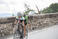 Road bike cycling. Woman road race cycling in the mountains Royalty Free Stock Photo