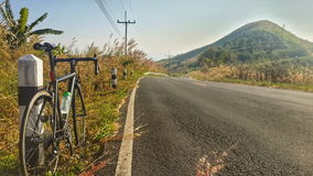 Road bike on hill Stock Images