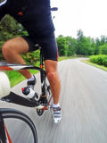 Road bike; male cyclist riding a racing bike downhill. Front view, large copy space of the right side. Sport and active life concept. Intentional motion blur royalty free stock images