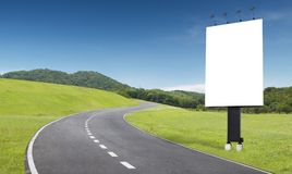 Road and billboard. Empty curve road with blank billboard beside royalty free stock image