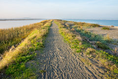 The road between the Black Sea and the Pomorie Salt Lake, Bulgaria Royalty Free Stock Image