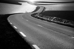 Winding country road in black and white Stock Image