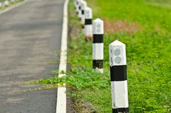 Road with black and white sign Royalty Free Stock Photo