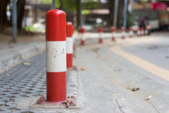 Road block pole. In straight line Stock Photo