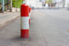 Road block pole. In straight line Stock Image