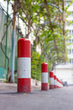 Road block pole. In straight line Stock Images