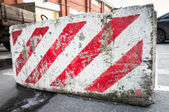 Road block with red and white diagonal pattern Stock Images