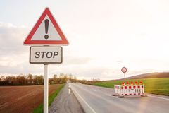 Road block with warning lights on road at countryside stock photos