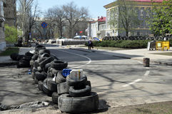 The road is blocked by buses. The photo was taken April 18, 2014. Pro-russian separatists seized a government building in Donetsk and require adherence to Russia Stock Image