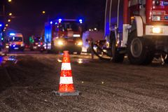 The road is blocked by a cone during fire extinguishing in the winter in the evening stock photography