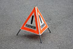 """Warning sign with the German word """"Feuerwehr"""" stock photos"""