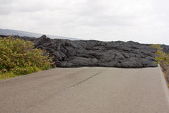 Road blocked by a lava flow Stock Images