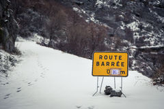 Road blocked sign on snow covered mountain road in Corsica Royalty Free Stock Photography