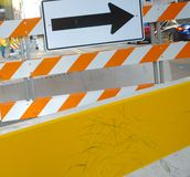 Road blocks and directions. A colorful details of a construction sight with arrows and striped barriers Stock Photo
