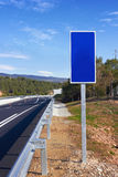 Road with blue sign pole Royalty Free Stock Photos