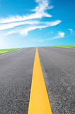 Road and blue sky Stock Images