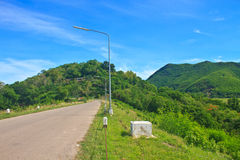 Road and blue sky on top of DAM Royalty Free Stock Photos