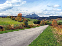 Road at Bobrovnik and Choc, Slovakia. Colorful countryside view of road at Bobrovnik in autumn. Great Choc (Veľký Choč) mountain can be seen in the stock image
