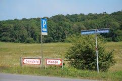 Road, Bornholm, Denmark. Signs showing the way to Hasle or Sandvig, Bornholm, Denmark royalty free stock photos