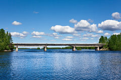Road bridge across the lake. In forests of Karelia, Russia Stock Image