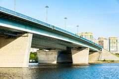 Road bridge across the river. Road bridge across the lake in the town royalty free stock photo