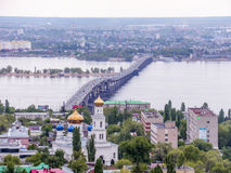 Road bridge across the Volga river between the cities of Saratov and Engels. The city`s skyline. An Orthodox Church. May Royalty Free Stock Photography