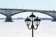 Road bridge across the Volga river between the cities of Saratov and Engels, Russia. Embankment, winter or spring day. Ice on the river Royalty Free Stock Image
