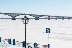 Road bridge across the Volga river between the cities of Saratov and Engels, Russia. Embankment, winter or spring day. Ice on the river Stock Photos