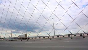Road through the bridge with blue sky and clouds stock video footage