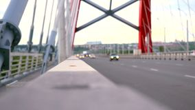 Road through the bridge with cloudy sky and moving stock footage