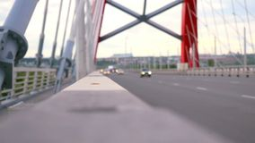 Road through the bridge with cloudy sky and moving stock video footage