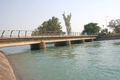 Road bridge on cool green river channel. Road bridge on fresh water canal Royalty Free Stock Images