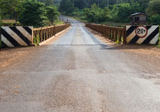 Road and bridge in countryside with nobody. Road in countryside of Pakse, Lao Royalty Free Stock Photos