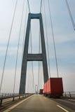 Road through the bridge in Denmark. Red trucks on the bridge in Denmark Stock Image