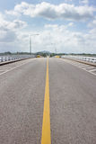 Road on the bridge and many clound in sky. Road on the bridge and many clound in blue sky Royalty Free Stock Photos