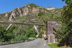 Road and bridge among mountains in France. Stock Photos